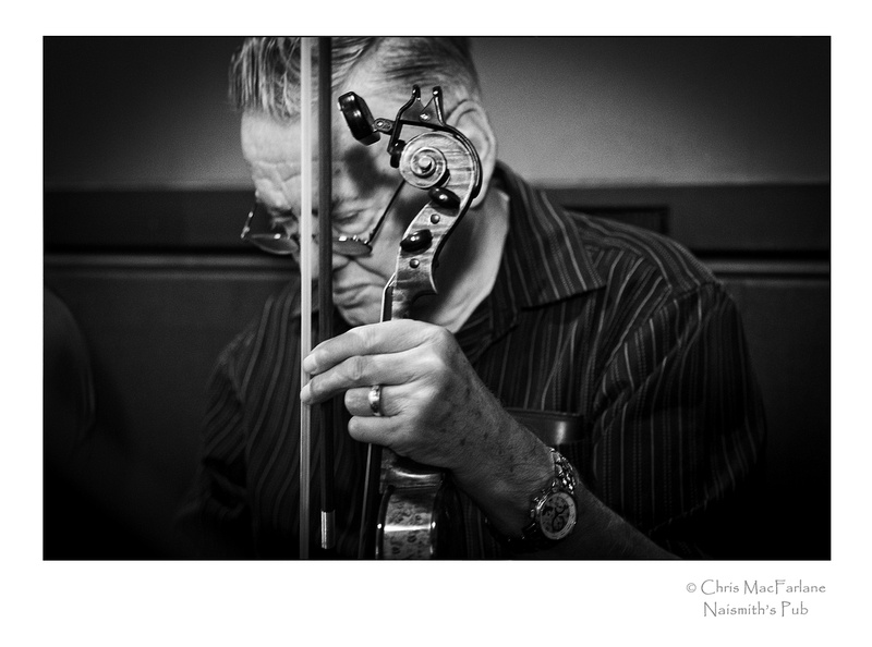 The Fiddler. A portrait of a fiddler a small town pub. Almonte, Ontario, Canada